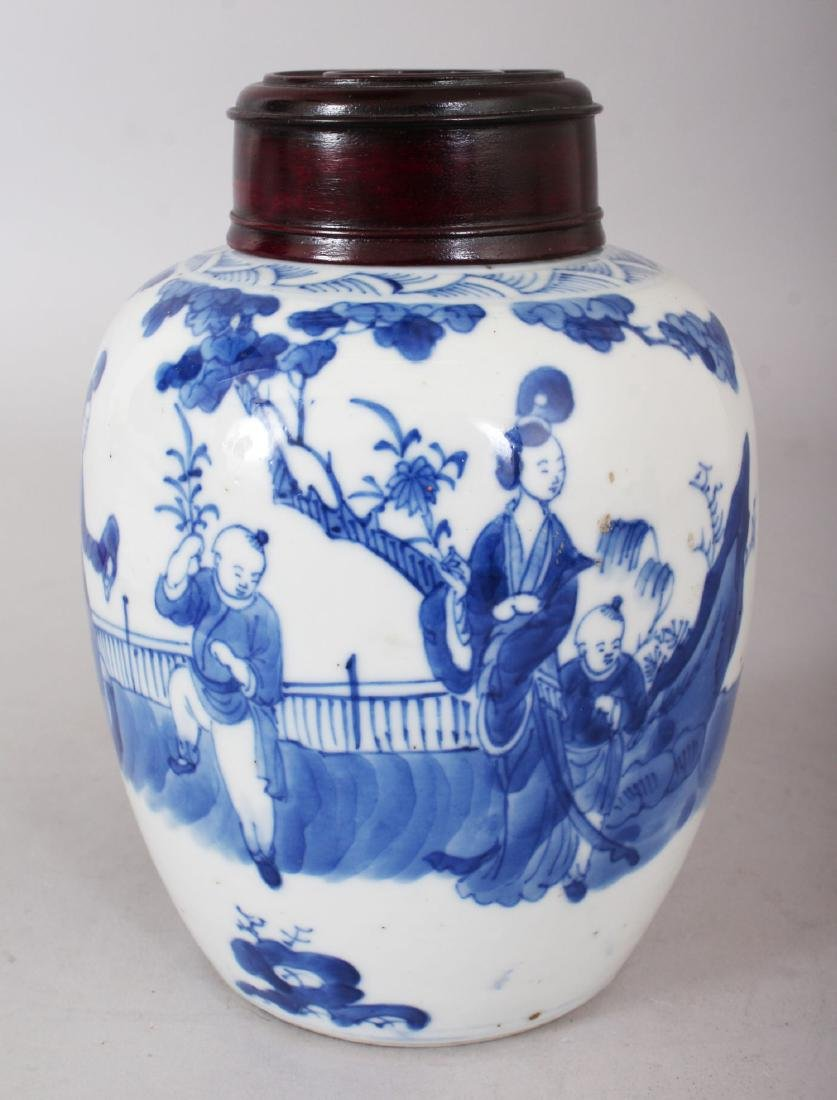 A CHINESE BLUE AND WHITE GINGER JAR AND COVER.  6ins