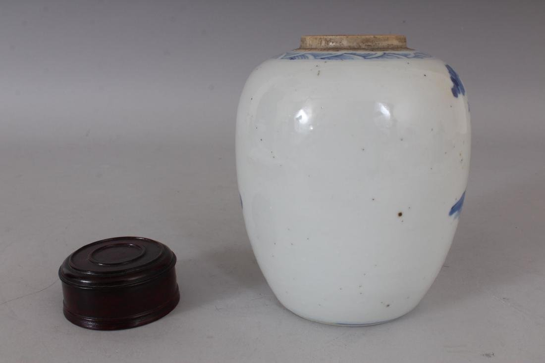 A CHINESE BLUE AND WHITE GINGER JAR AND COVER.  6ins - 2