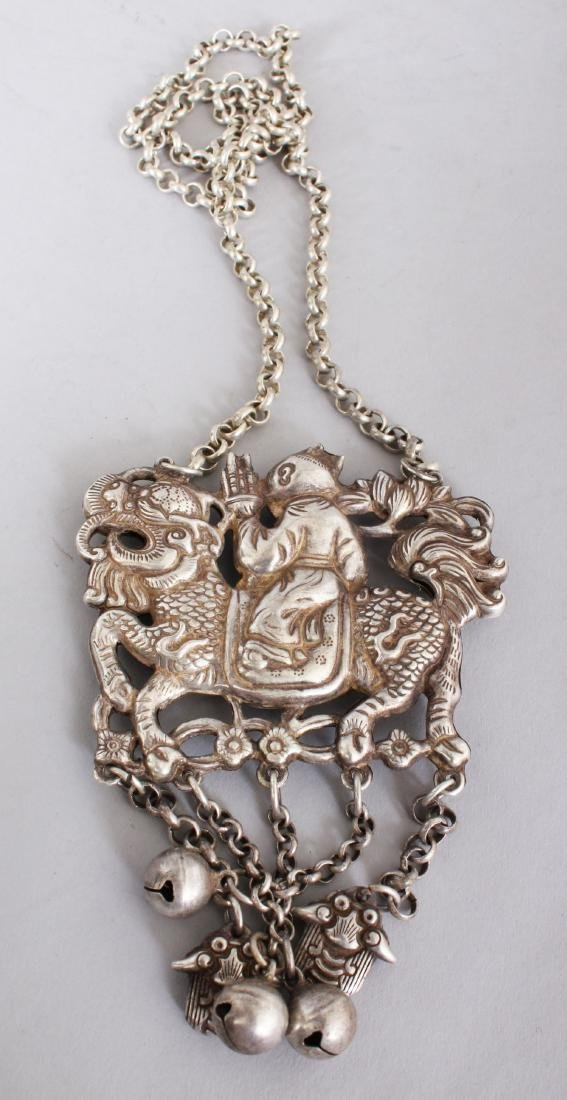 A CHINESE SILVER NECKLACE, man on a dragon.