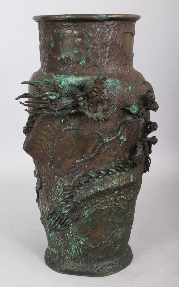 A JAPANESE BRONZE VASE, cast with an entwined dragon.