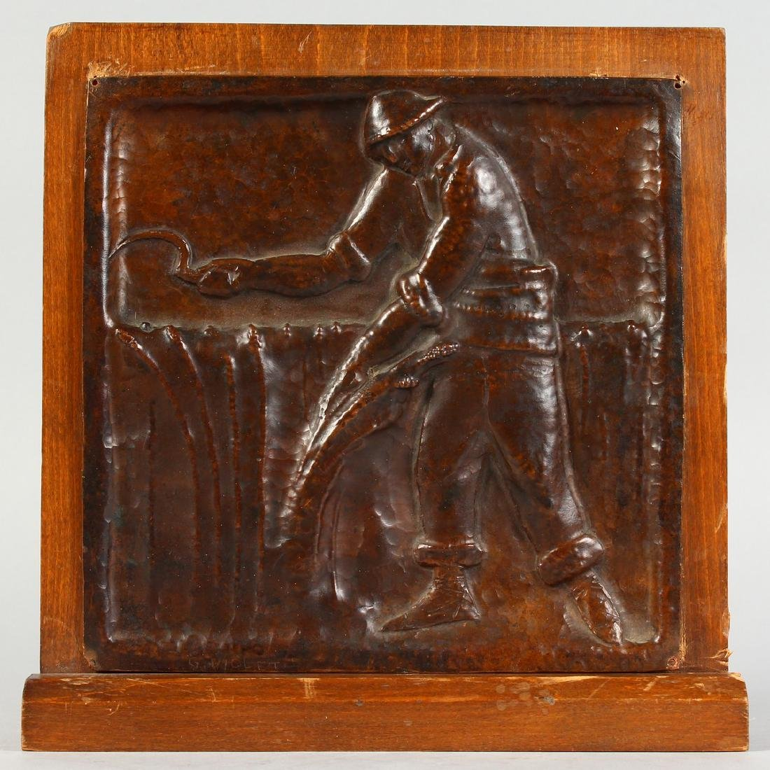 AN ARTS & CRAFTS COPPER PLAQUE, embossed with a man