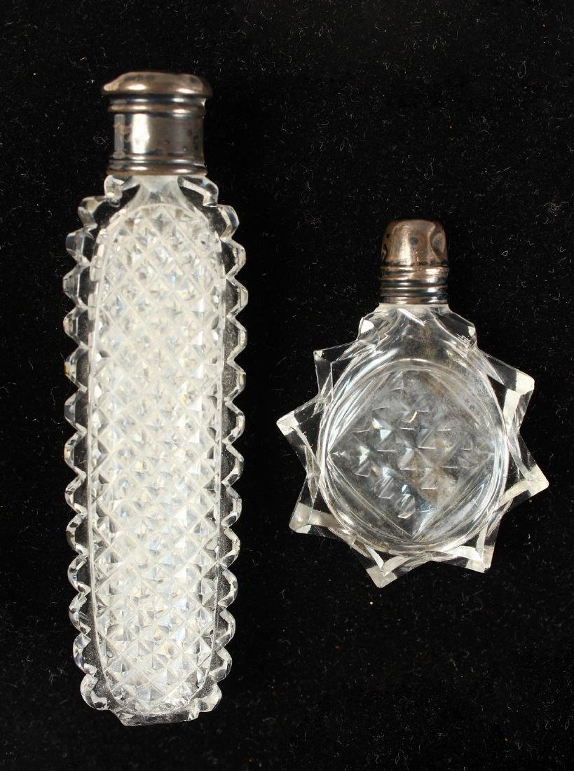 TWO SILVER TOP CUT GLASS SCENT BOTTLES.