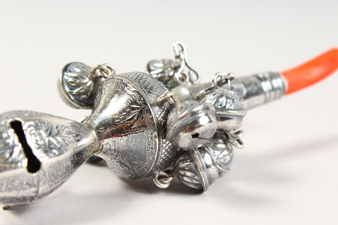 A SILVER AND CORAL NINE BELL RATTLE.  5.5ins long. - 3