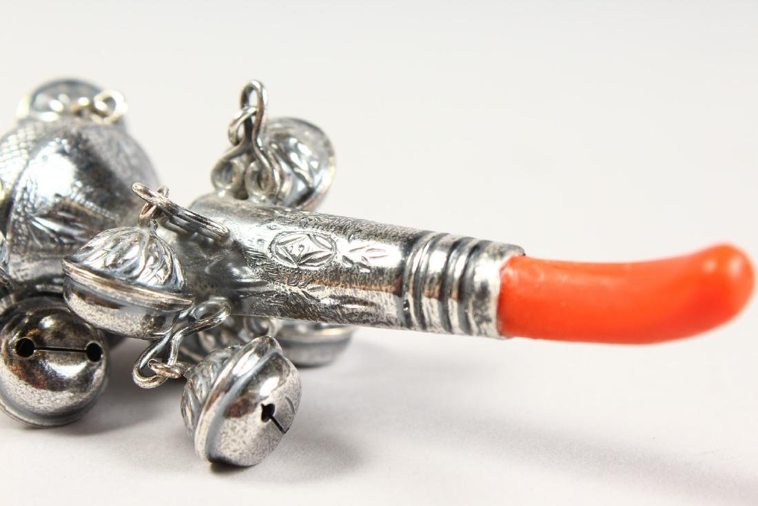 A SILVER AND CORAL NINE BELL RATTLE.  5.5ins long. - 4
