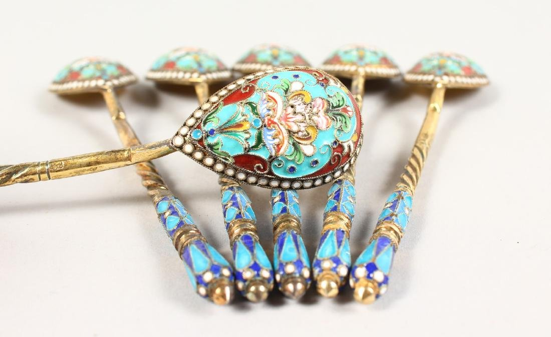 A SET OF SIX RUSSIAN SILVER AND ENAMEL DECORATED
