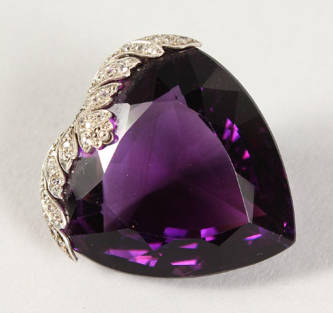A LARGE HEART SHAPED DIAMOND MOUNTED AMETHYST PENDANT. - 2