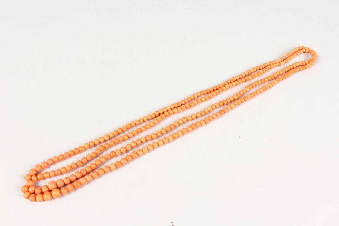 A LONG CORAL SINGLE STONE NECKLACE. - 2