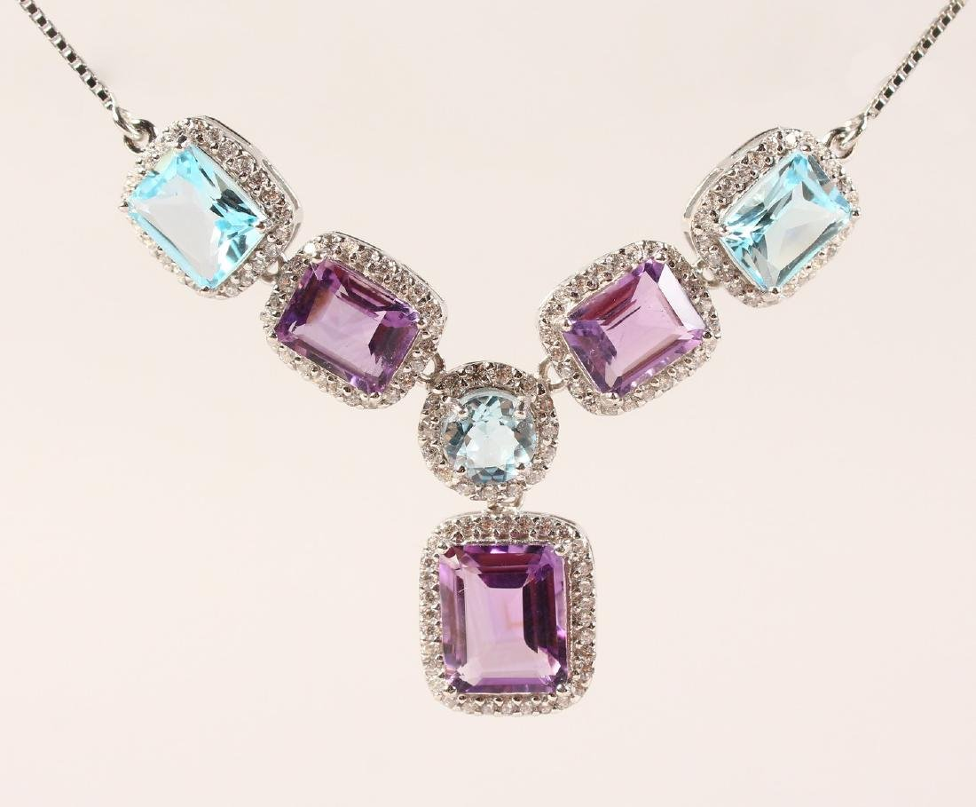 A SILVER, BLUE TOPAZ AND AMETHYST NECKLACE.