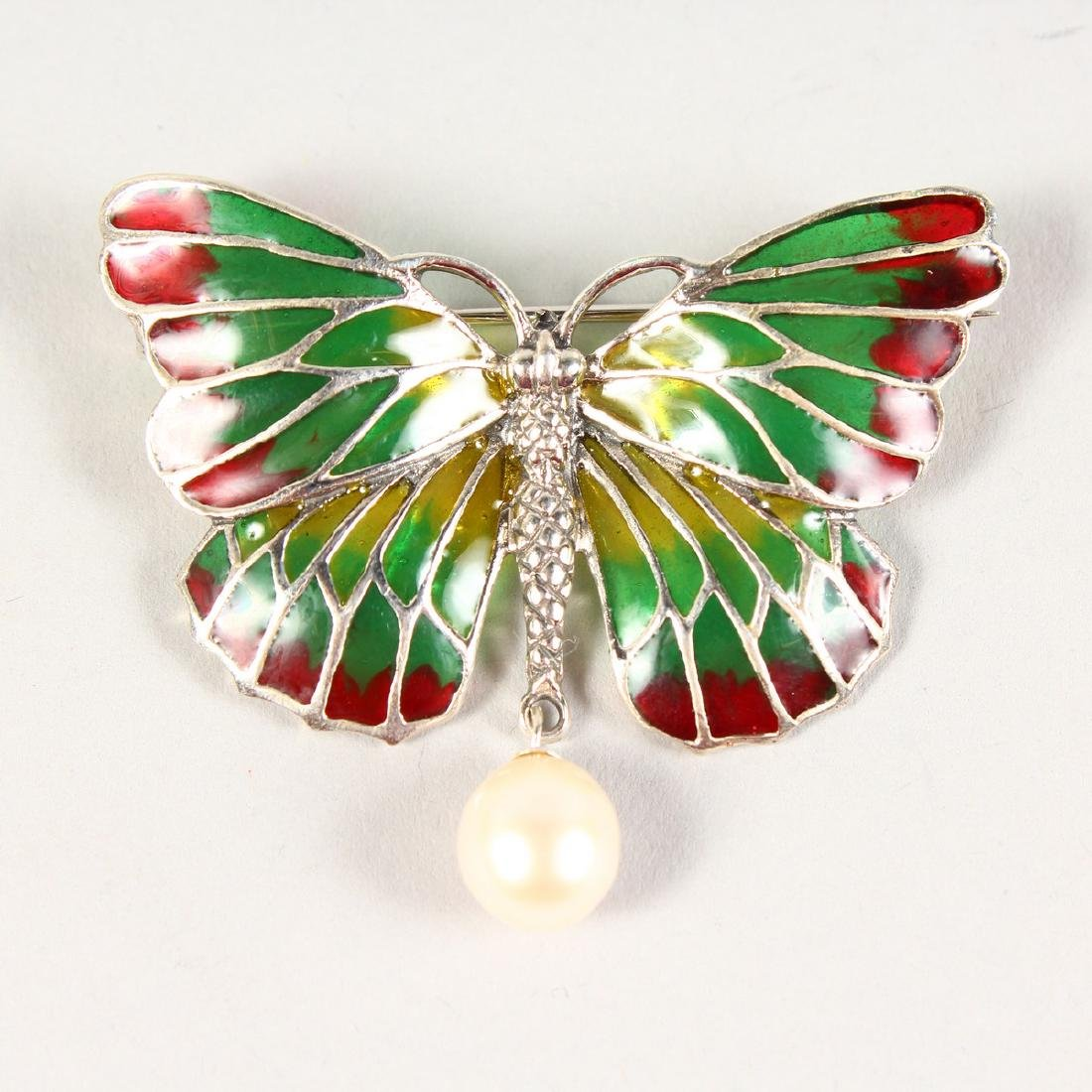 A SILVER AND PLIQUE JOUR ENAMEL BUTTERFLY BROOCH.