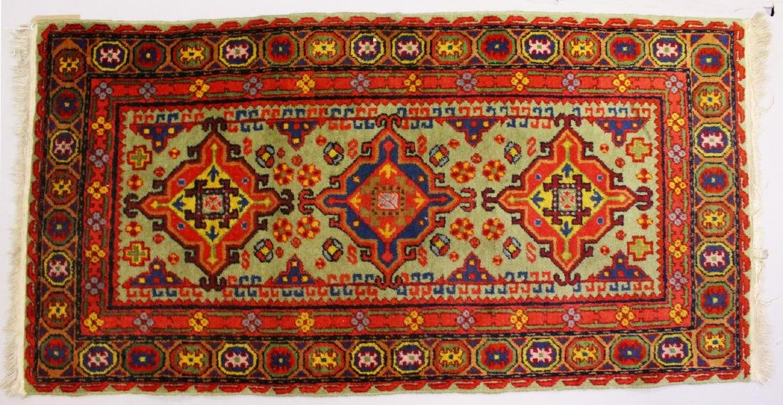 A PERSIAN RUG, with three central motifs.  5ft x 2ft