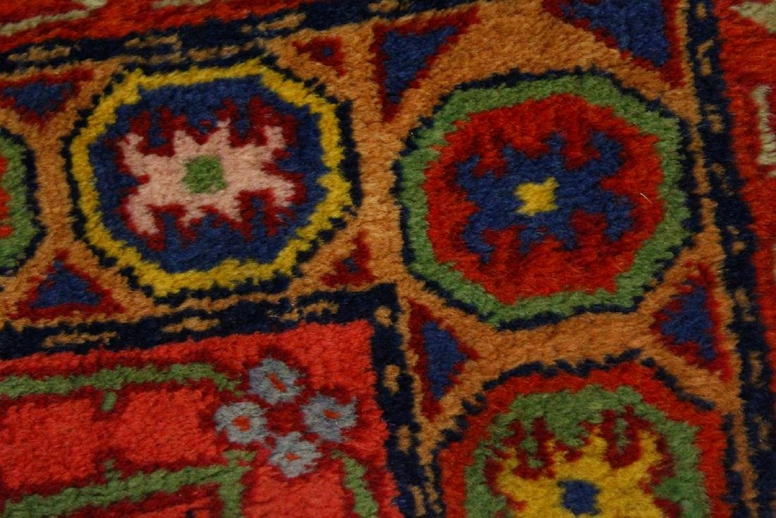 A PERSIAN RUG, with three central motifs.  5ft x 2ft - 5