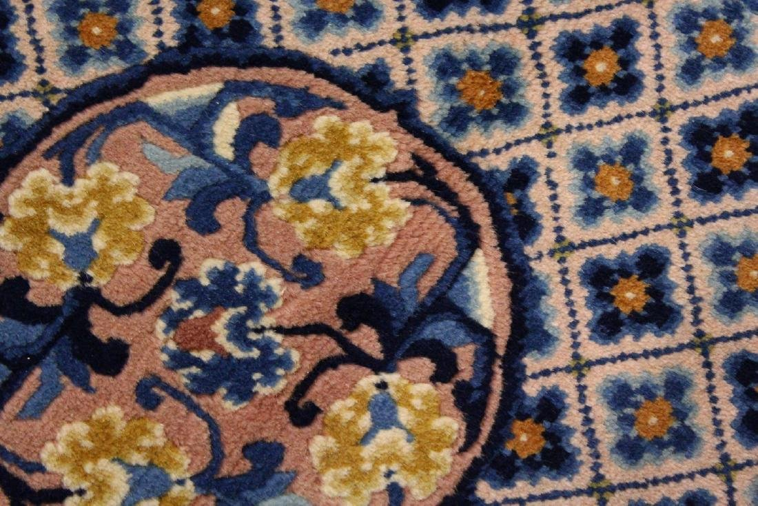 A CHINESE RUG, with three central motifs and blue - 2