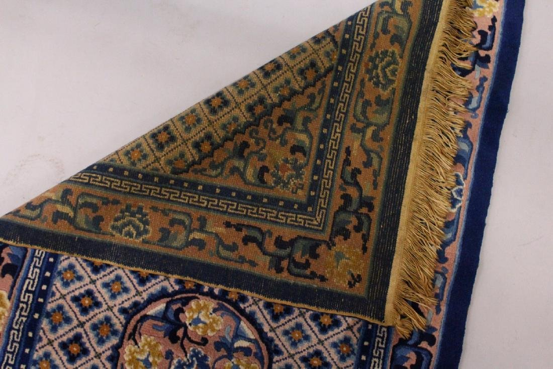 A CHINESE RUG, with three central motifs and blue - 4