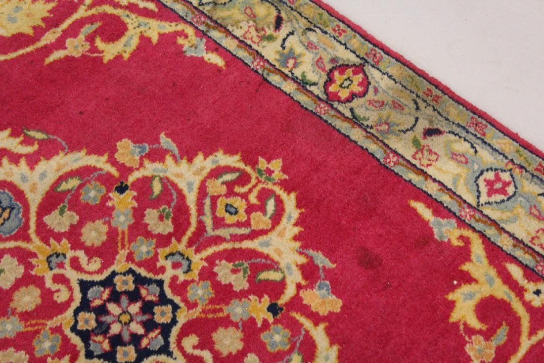 A PERSIAN RUNNER RUG, with central ground, on a rose - 2