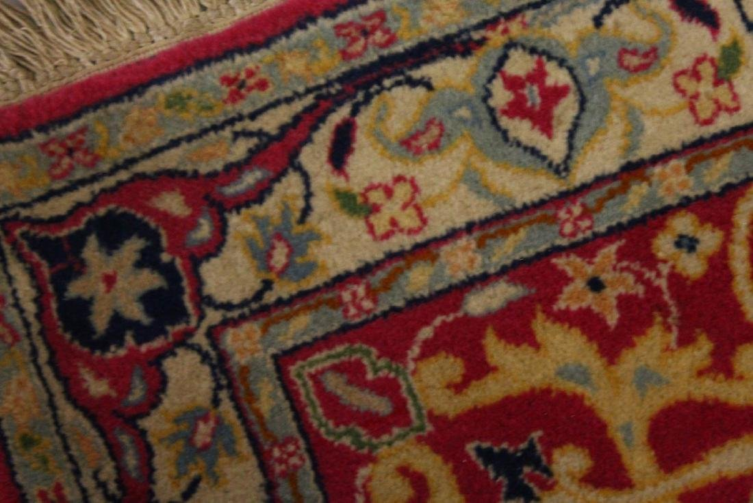 A PERSIAN RUNNER RUG, with central ground, on a rose - 4