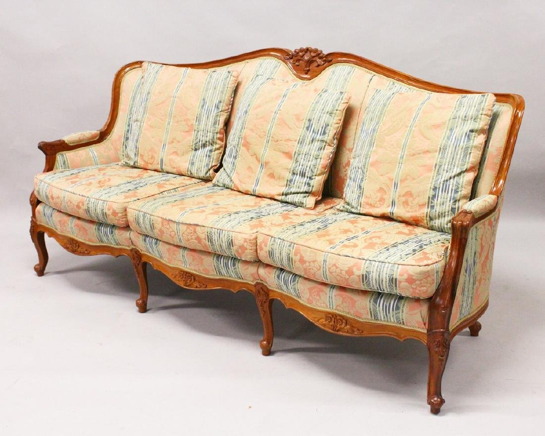 A MODERN FRENCH STYLE THREE-SEATER SETTEE, with carved