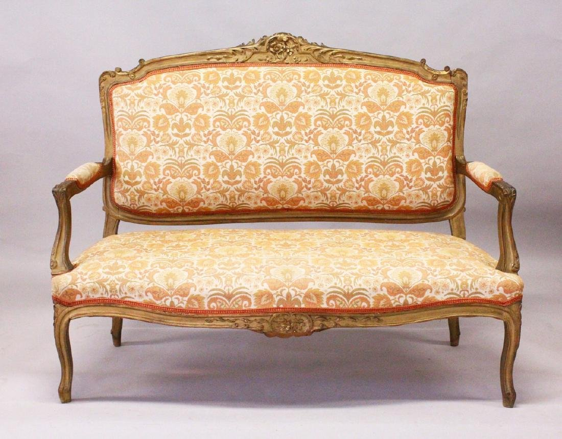 A 19TH CENTURY FRENCH SETTEE, with carved and gilded