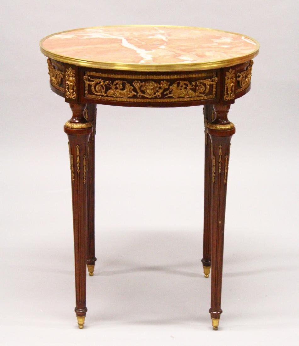 A LOUIS XVI DESIGN CIRCULAR TABLE, with marble top,