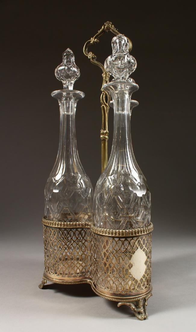 A GOOD SET OF THREE CUT GLASS TALL DECANTERS AND