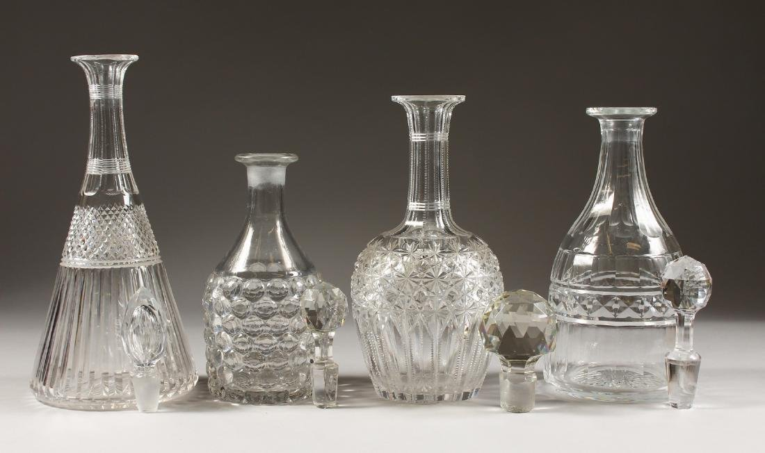 FOUR VARIOUS DECANTERS.
