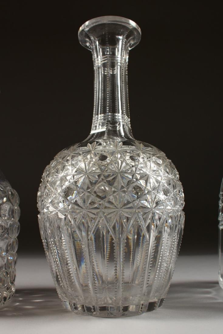 FOUR VARIOUS DECANTERS. - 4