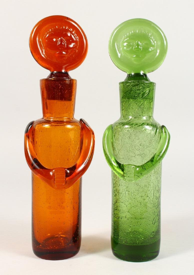 AN UNUSUAL PAIR OF GLASS BOTTLES, modelled as standing