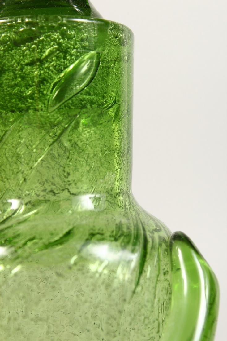 AN UNUSUAL PAIR OF GLASS BOTTLES, modelled as standing - 2