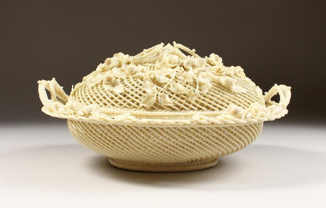 A VERY GOOD BELLEEK OVAL PIERCED BASKET AND COVER,