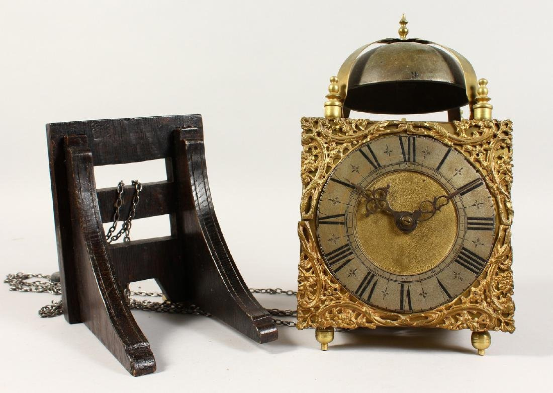 A GOOD BRASS LANTERN CLOCK, with bell, square face and