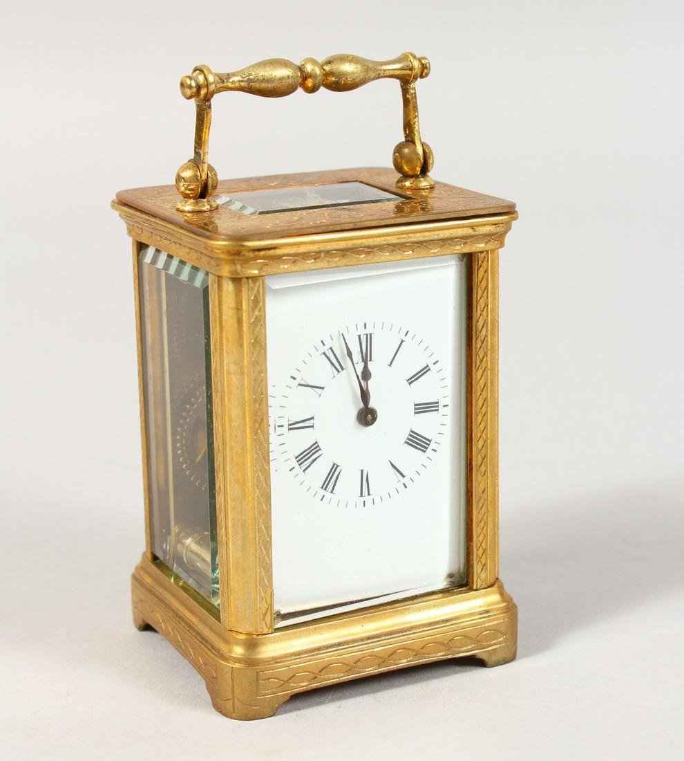 A GOOD FRENCH MINIATURE CARRIAGE CLOCK.  2.5ins high.