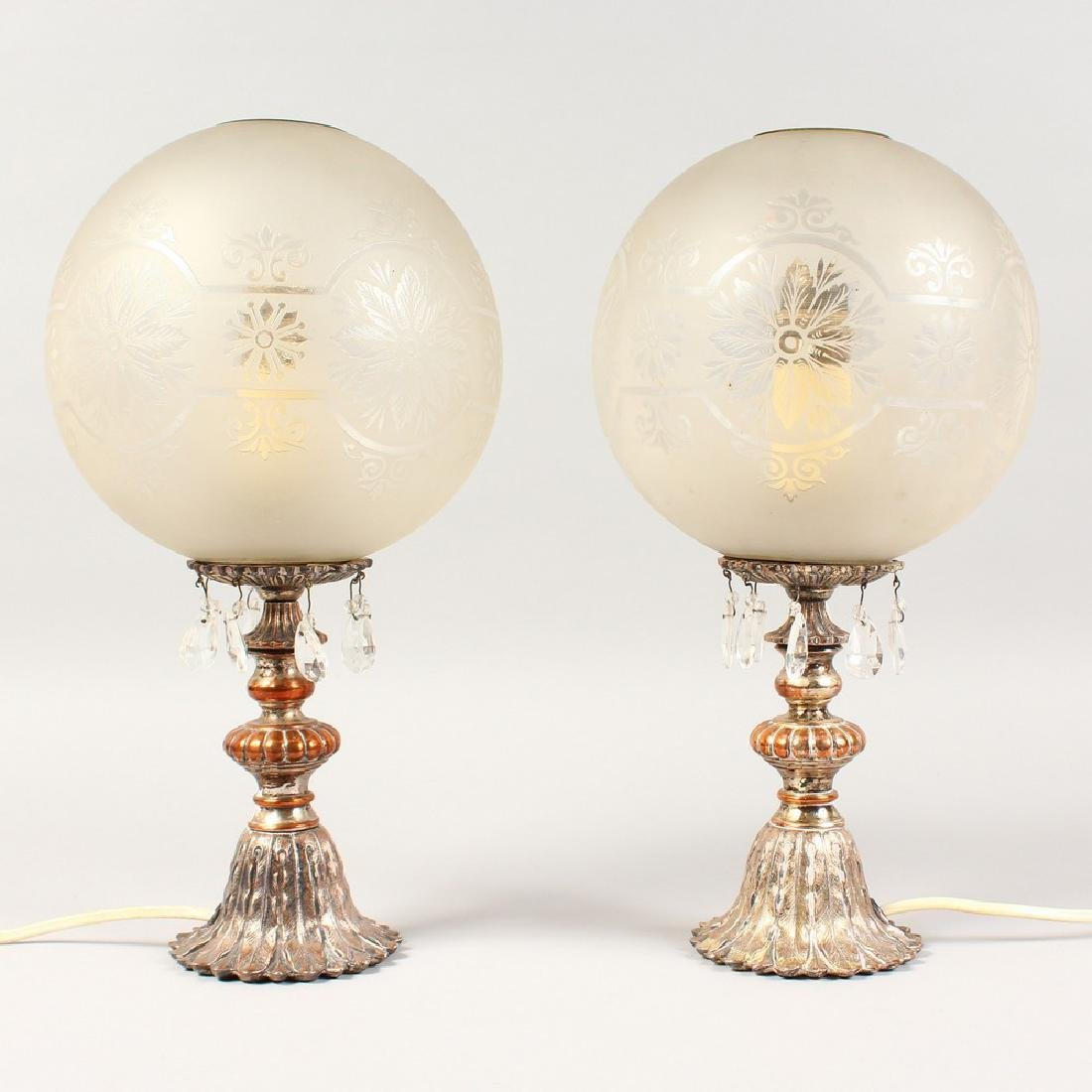 A PAIR OF METAL LAMPS with prism drops and frosted