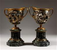 A PAIR OF FRENCH BRONZE AND SILVERED BRONZE CLASSICAL