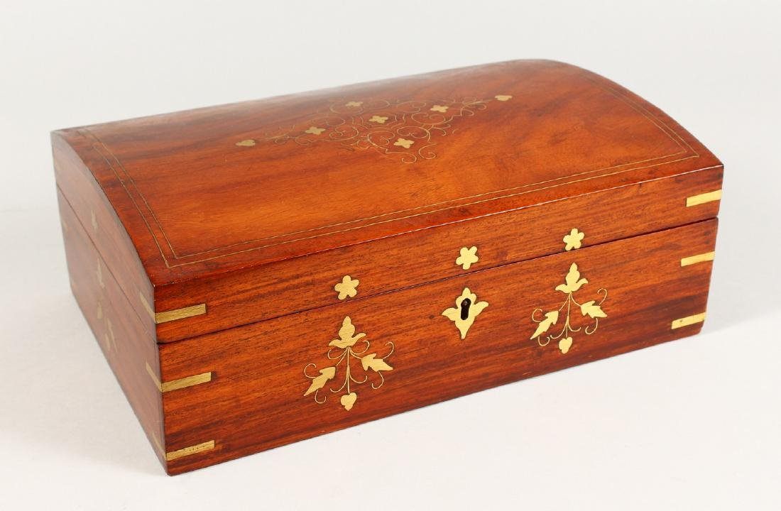 A MAHOGANY DOME TOP JEWELLERY BOX, with brass inlaid