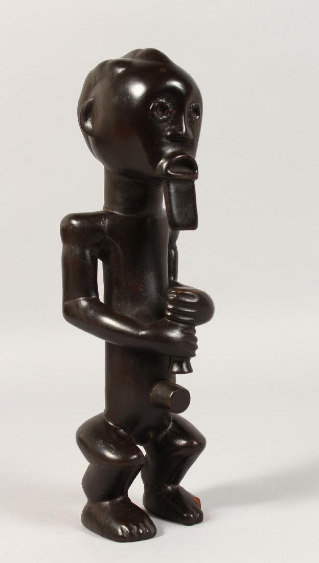 A SMALL FANG TRIBE SEATED FIGURE of a bearded man.