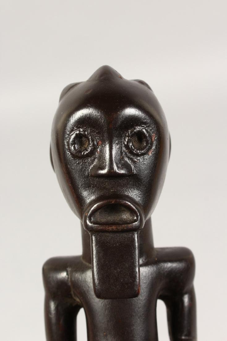 A SMALL FANG TRIBE SEATED FIGURE of a bearded man. - 2