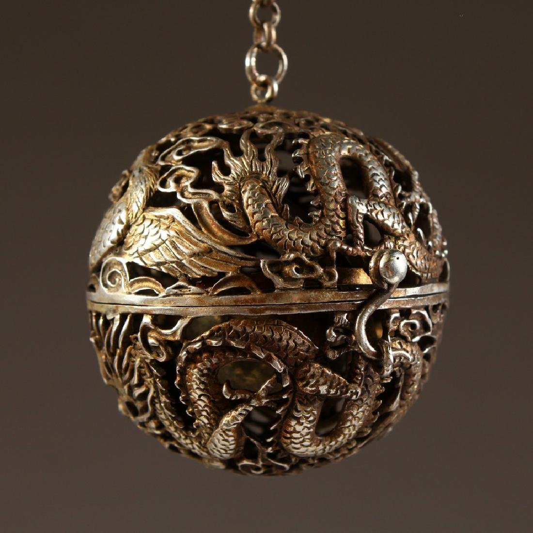 A CHINESE PIERCED BALL TRAVELLING CENSER.