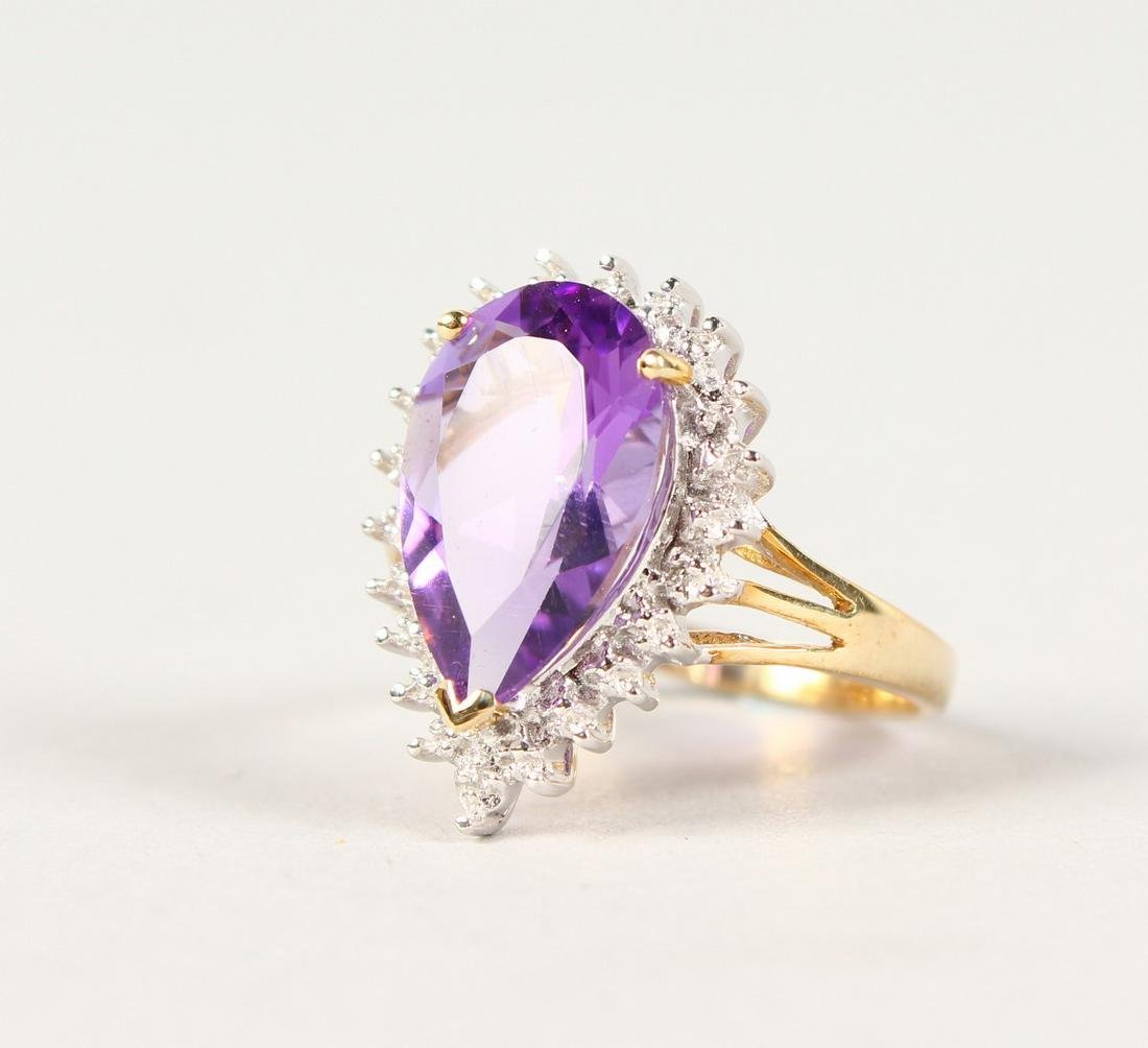 A 9CT GOLD, PEAR SHAPE AMETHYST AND DIAMOND RING.