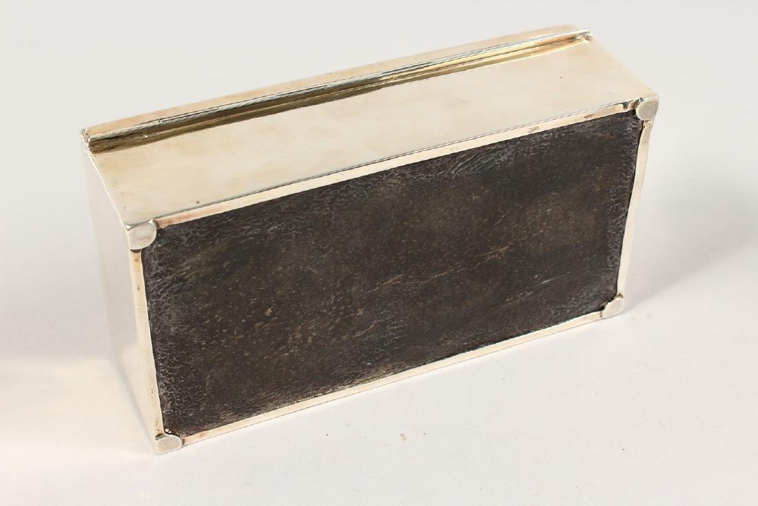 A RECTANGULAR ENGINE TURNED CIGARETTE BOX.  6.75ins - 9