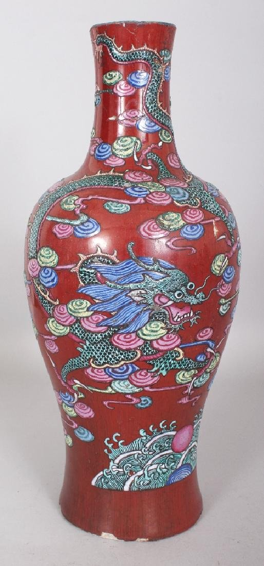 A 19TH CENTURY CHINESE FAMILLE ROSE LIVER RED GROUND