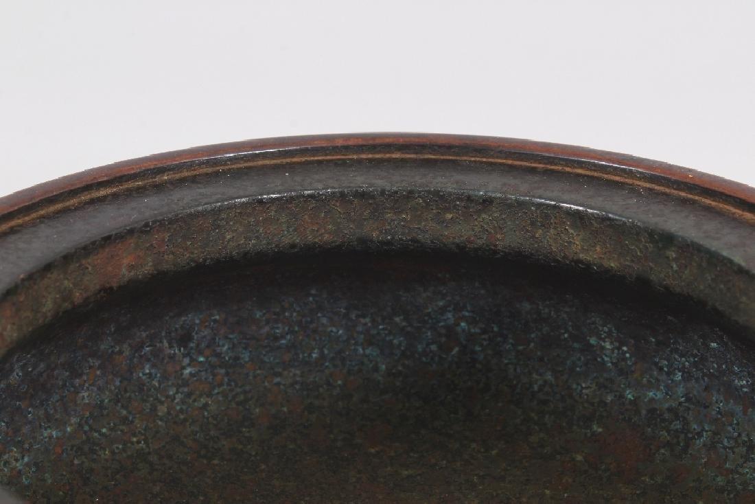 A CHINESE BRONZE ISLAMIC MARKET TRIPOD CENSER, weighing - 4