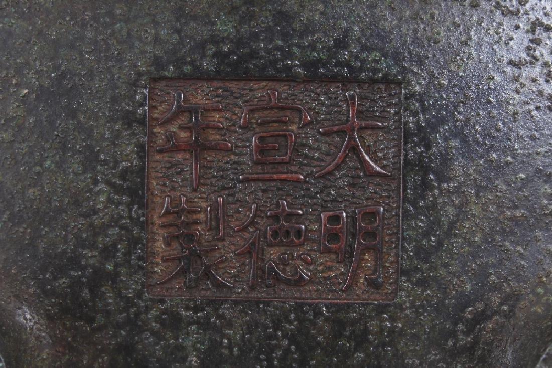 A CHINESE BRONZE ISLAMIC MARKET TRIPOD CENSER, weighing - 7