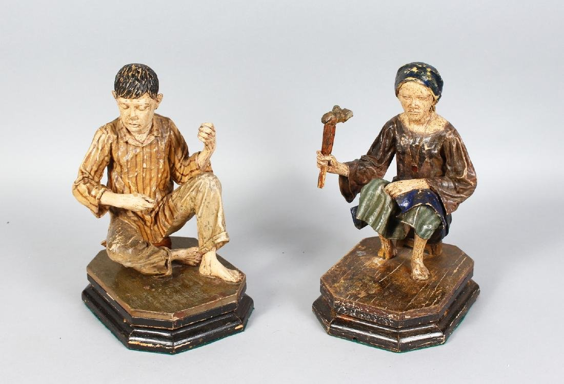 A PAIR OF 19TH CENTURY CARVED WOOD FIGURES, a seated