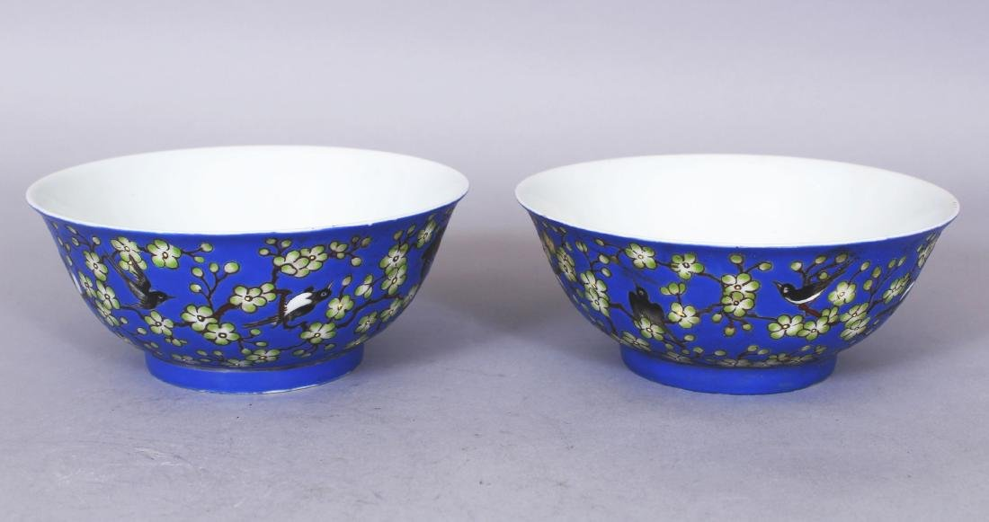 A PAIR OF CHINESE BLUE GROUND PORCELAIN BOWLS, each