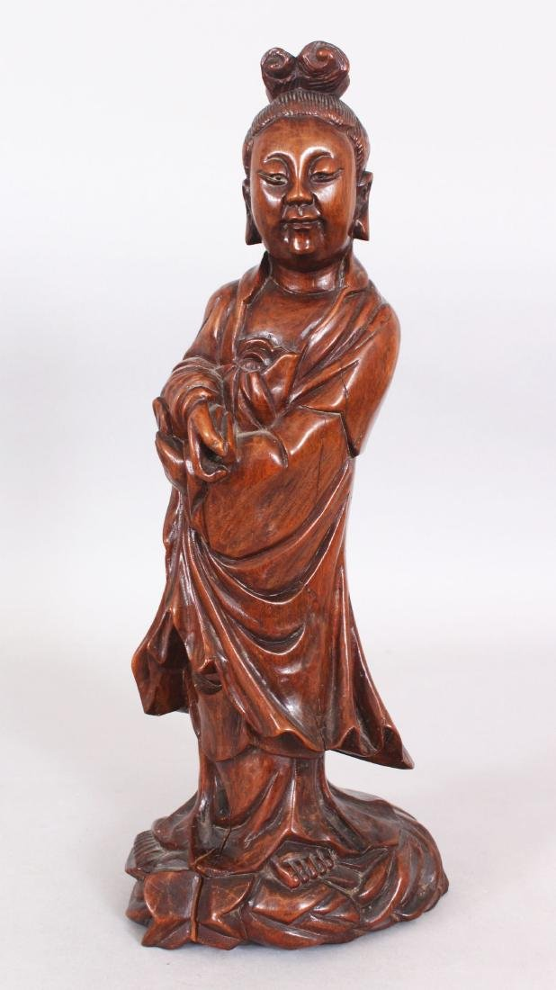 A 19TH/20TH CENTURY CHINESE CARVED WOOD FIGURE OF A