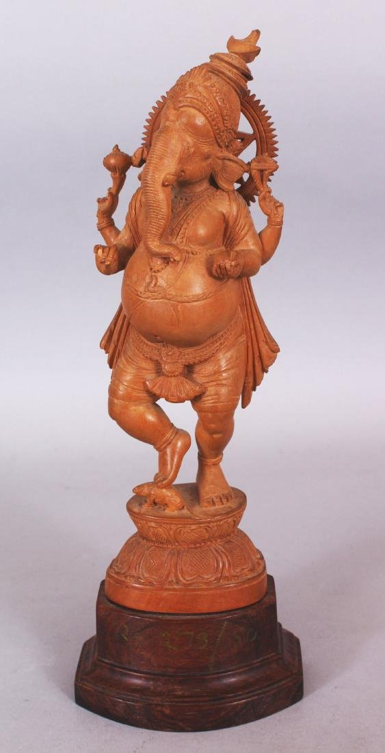 A GOOD QUALITY 20TH CENTURY INDIAN WOOD FIGURE OF