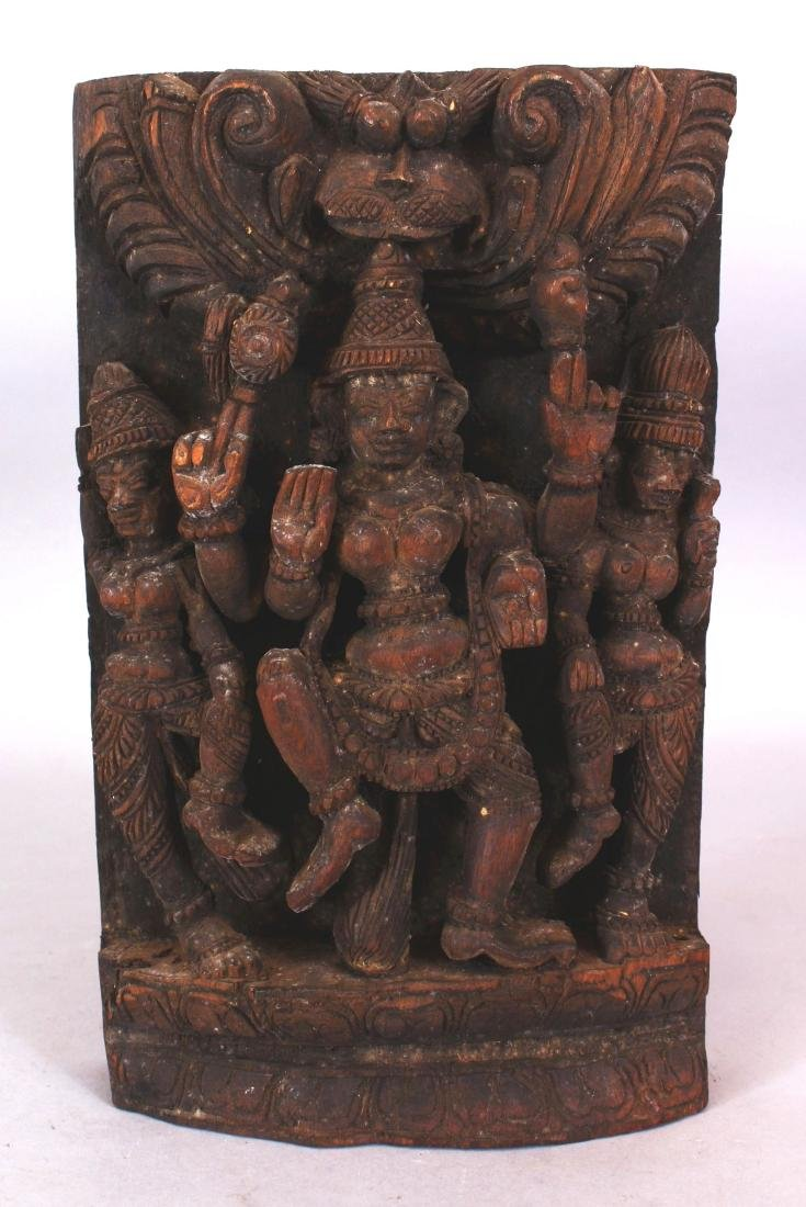A SIMILAR 20TH CENTURY INDIAN WOOD TEMPLE CARVING,