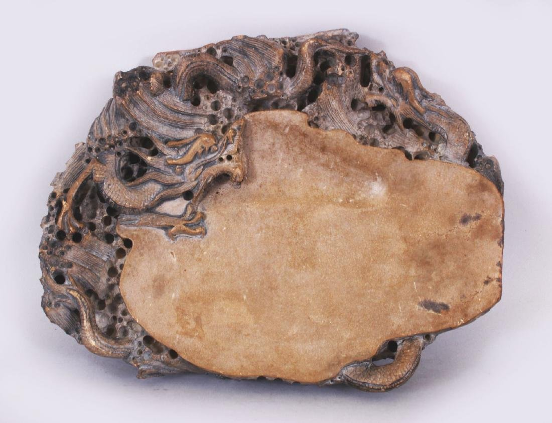 A LARGE CHINESE DRAGON INK STONE, the stone of beige