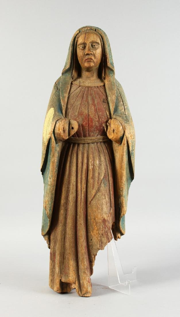 AN EARLY CARVED WOOD FIGURE OF THE MADONNA, for