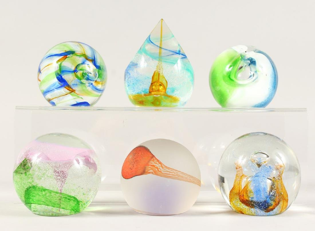 SIX VARIOUS SIGNED GLASS PAPERWEIGHTS.