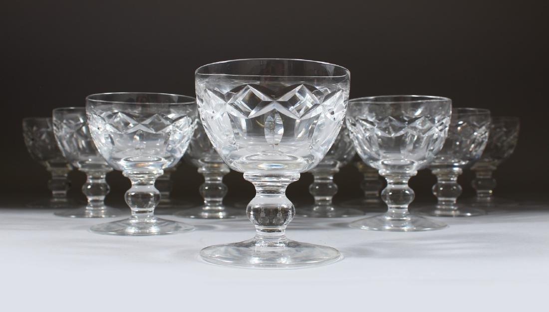 A SET OF TWELVE CUT CRYSTAL WINE GLASSES.